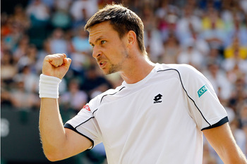 LONDON, ENGLAND - JUNE 30:  Robin Soderling of Sweden celebrates a point during his Quarter Final match against Rafael Nadal of Spain on Day Nine of the Wimbledon Lawn Tennis Championships at the All England Lawn Tennis and Croquet Club on June 30, 2010 i