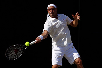 LONDON, ENGLAND - JUNE 22:  Marcos Baghdatis of Cyprus in action during the first round match against Lukas Lacko of Slovakia on Day Two of the Wimbledon Lawn Tennis Championships at the All England Lawn Tennis and Croquet Club on June 22, 2010 in London,