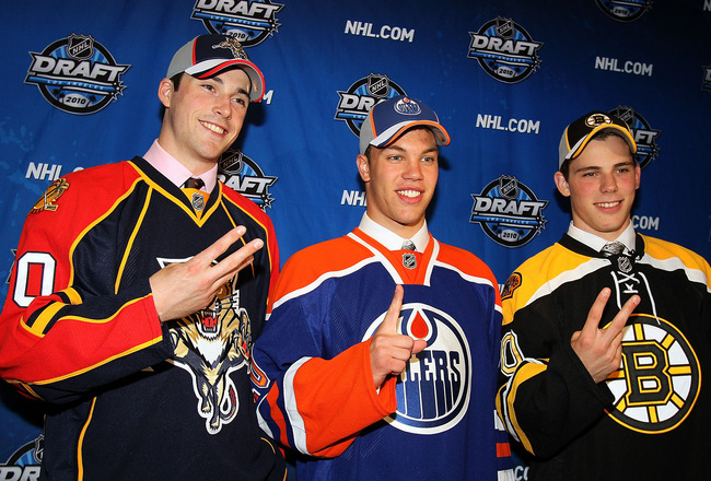 LOS ANGELES, CA - JUNE 25:  (L-R) Erik Gudbranson, drafted third overall by the Florida Panthers, Taylor Hall, drafted #1 overall by the Edmonton Oilers and Tyler Seguin, drafted second overall by the Boston Bruins pose during the 2010 NHL Entry Draft at
