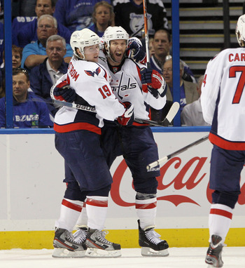 TAMPA, FL - MAY 03:  Mike Knuble #22 of the Washington Capitals (R) scores at 59 seconds of the second period against the Tampa Bay Lightning and is hugged by Nicklas Backstrom #19 (L) in Game Three of the Eastern Conference Semifinals during the 2011 NHL