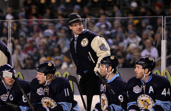 PITTSBURGH, PA - JANUARY 01:  Head coach Dan Bylsma talks with players on the bench during the 2011 NHL Bridgestone Winter Classic against the Washington Capitals at Heinz Field on January 1, 2011 in Pittsburgh, Pennsylvania.  (Photo by Jamie Squire/Getty