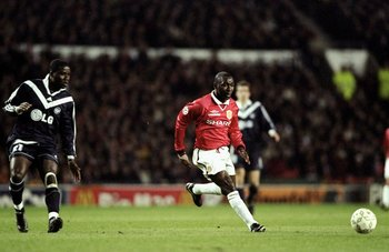 1 Mar 2000:  Andy Cole of Manchester United is watched by Kodjo Afanou of Bordeaux during the UEFA Champions League group B match at Old Trafford in Manchester, England. United won 2-0. \ Mandatory Credit: Alex Livesey /Allsport