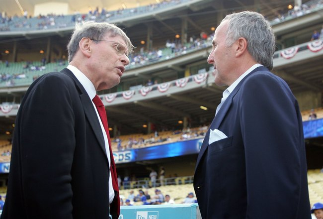 LOS ANGELES, CA - OCTOBER 07:  (L-R) MLB commissioner Bud Selig talks with Los Angeles Dodgers owner Frank McCourt before Game Three of the National League Division Series between the New York Mets and the Dodgers on October 7, 2006 at Dodger Stadium in L
