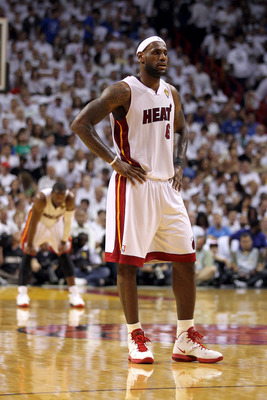 MIAMI, FL - JUNE 12:  LeBron James #6 of the Miami Heat looks on as Dwyane Wade stands in the background against the Dallas Mavericks in Game Six of the 2011 NBA Finals at American Airlines Arena on June 12, 2011 in Miami, Florida. NOTE TO USER: User expr