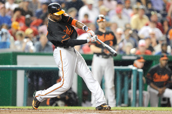 WASHINGTON, DC - JUNE 17:  Adam Jones #10 of the Baltimore Orioles hits a double in the third inning against the Washington Nationals at Nationals Park on June 17, 2011 in Washington, DC.  (Photo by Greg Fiume/Getty Images)