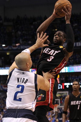 DALLAS, TX - JUNE 09:  Dwyane Wade #3 of the Miami Heat with the ball against Jason Kidd #2 of the Dallas Mavericks in Game Five of the 2011 NBA Finals at American Airlines Center on June 9, 2011 in Dallas, Texas.  NOTE TO USER: User expressly acknowledge
