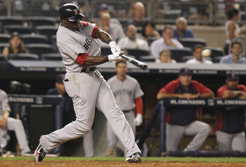 NEW YORK, NY - JUNE 09: Mike Cameron #23 of the Boston Red Sox hits a RBI double in the seventh inning against the New York Yankees on June 9, 2011 at Yankee Stadium in the Bronx borough of New York City.  (Photo by Nick Laham/Getty Images)
