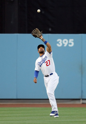 LOS ANGELES, CA - JUNE 17:  Matt Kemp #27 of the Los Angeles Dodgers catches a fly ball for an out in the first inning during the MLB game against the Houston Astros at Dodger Stadium on June 17, 2011 in Los Angeles, California.  (Photo by Victor Decolong