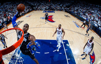 ATLANTA, GA - APRIL 28:  Dwight Howard #12 of the Orlando Magic dunks against the Atlanta Hawks during Game Six of the Eastern Conference Quarterfinals in the 2011 NBA Playoffs at Philips Arena on April 28, 2011 in Atlanta, Georgia.  NOTE TO USER: User ex