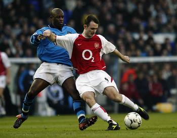MANCHESTER - FEBRUARY 22:  Francis Jeffers of Arsenal is tackled by David Sommeil of Manchester City during the FA Barclaycard Premiership match held on February 22, 2003 at Maine Road, in Manchester, England. Arsenal won the match 5-1. (Photo by Bryn Len