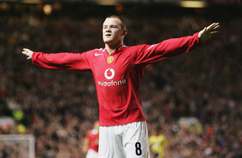 MANCHESTER, ENGLAND - SEPTEMBER 28:  Wayne Rooney of Manchester United celebrates his second goal during the UEFA Champions League Group D match between Manchester United and Fenerbahce SK at Old Trafford on September 28, 2004 in Manchester, England.  (Ph