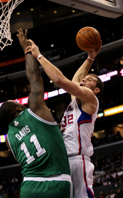 LOS ANGELES, CA - FEBRUARY 26:  Blake Griffin #32 of the Los Angeles Clippers goes for a dunk over Glen Davis #11 of the Boston Celtics at Staples Center on February 26, 2011  in Los Angeles, California. The Celtics won 99-92.  NOTE TO USER: User expressl