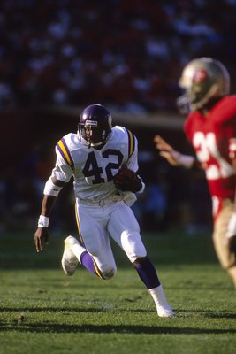 SAN FRANCISCO - OCTOBER 30:  Running back D. J. Dozier #42 of the Minnesota Vikings rushes for yards against the San Francisco 49ers during a game at Candlestick Park on October 30, 1988 in San Francisco, California.  The 49er won 24-21.  (Photo by George