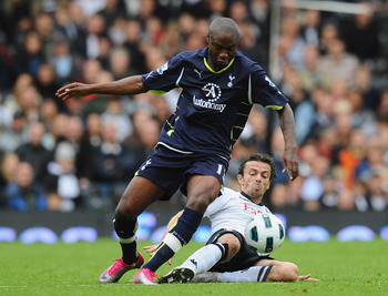 LONDON, ENGLAND - OCTOBER 16:  William Gallas of Tottenham is challenged by Simon Davies of Fulham during the Barclays Premier League match between Fulham and Tottenham Hotspur at Craven Cottage on October 16, 2010 in London, England.  (Photo by Mike Hewi