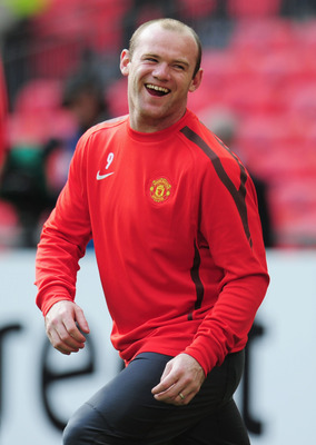 LONDON, ENGLAND - MAY 27:  Wayne Rooney of Manchetser United laughs during a Manchester United training session prior to the UEFA Champions League final versus Barcelona at Wembley Stadium on May 27, 2011 in London, England.  (Photo by Shaun Botterill/Get