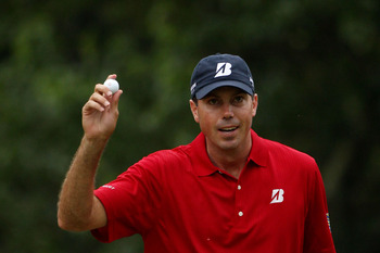 BETHESDA, MD - JUNE 18:  Matt Kuchar waves to the gallery on the 13th green during the third round of the 111th U.S. Open at Congressional Country Club on June 18, 2011 in Bethesda, Maryland.  (Photo by Andrew Redington/Getty Images)