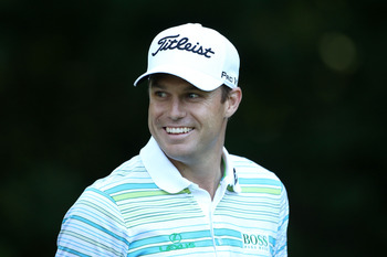 BETHESDA, MD - JUNE 15:  Nick Watney smiles as he walks off a tee box during a practice round prior to the start of the 111th U.S. Open at Congressional Country Club on June 15, 2011 in Bethesda, Maryland.  (Photo by Andrew Redington/Getty Images)