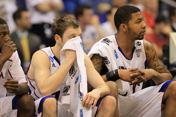 SAN ANTONIO, TX - MARCH 27:  (L-R) Brady Morningstar #12 and Markieff Morris #21 of the Kansas Jayhawks react during the southwest regional final of the 2011 NCAA men's basketball tournament against the Virginia Commonwealth Rams at the Alamodome on March