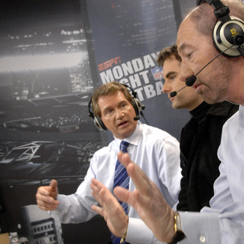 ESPN 's Joe Theismann and Tony Kornheisher talks with NASCAR driver Jeff Gordon on Monday Night Football Nov. 13, 2006 as the Carolina Panthers host the Tampa Bay Buccaneers  in Charlotte.  The Panthers won 24 - 10.  (Photo by Al Messerschmidt/Getty Image