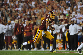 LANDOVER - SEPTEMBER 12:  Chris Cooley #47 of the Washington Redskins runs the ball during the NFL season opener against the Dallas Cowboys at FedExField on September 12, 2010 in Landover, Maryland. The Redskins defeated the Cowboys 13-7. (Photo by Larry