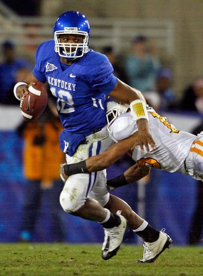 LEXINGTON, KY - NOVEMBER 28:  Morgan Newton #12 of the Kentucky Wildcats is tackled by Janzen Jackson #15 of the Tennessee Volunteers during the SEC game at Commonwealth Stadium on November 28, 2009 in Lexington, Kentucky.  (Photo by Andy Lyons/Getty Imag