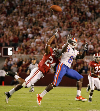 TUSCALOOSA, AL - OCTOBER 02:  Omarius Hines #82 of the Florida Gators fails to pull in this reception against DeQuan Menzie #24 of the Alabama Crimson Tide at Bryant-Denny Stadium on October 2, 2010 in Tuscaloosa, Alabama.  (Photo by Kevin C. Cox/Getty Im