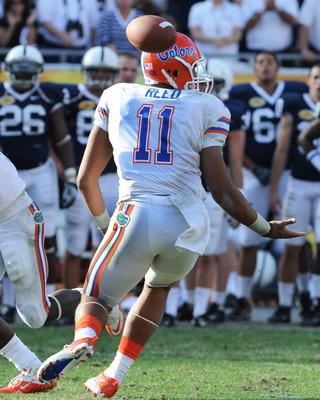 TAMPA, FL - JANUARY 1:  Quarterback Tyler Murphy #11 of the Florida Gators fumbles a snap against the Penn State Nittany Lions January 1, 2011 in the 25th Outback Bowl at Raymond James Stadium in Tampa, Florida.  (Photo by Al Messerschmidt/Getty Images)