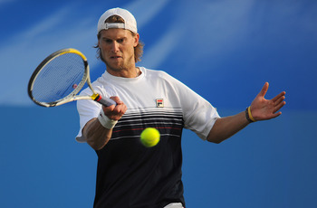 EASTBOURNE, ENGLAND - JUNE 18:  Andreas Seppi of Italy plays a shot in his final against Janko Tipsarevic of Serbia during day 8 of the AEGON International tennis tournament on June 18, 2011 in Eastbourne, England.  (Photo by Michael Regan/Getty Images)