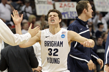 DENVER, CO - MARCH 19:  Jimmer Fredette #32 of the Brigham Young Cougars celebrates after a play against the Gonzaga Bulldogs during the third round of the 2011 NCAA men's basketball tournament at Pepsi Center on March 19, 2011 in Denver, Colorado.  (Phot