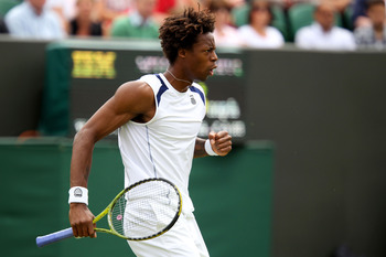 LONDON, ENGLAND - JUNE 20:  Gael Monfils of France reacts to a play during his first round match against Matthias Bachinger of Germany on Day One of the Wimbledon Lawn Tennis Championships at the All England Lawn Tennis and Croquet Club on June 20, 2011 i