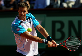 PARIS, FRANCE - JUNE 01:  Robin Soderling of Sweden hits a backhand during the men's singles quarterfinal match between Rafael Nadal of Spain and Robin Soderling of Sweden on day eleven of the French Open at Roland Garros on June 1, 2011 in Paris, France.