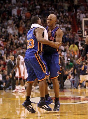 MIAMI, FL - FEBRUARY 27:  Chauncey Billups #4 of the New York Knicks is congratulated by teammate Toney Douglas #23 during a game against the Miami Heat at American Airlines Arena on February 27, 2011 in Miami, Florida. NOTE TO USER: User expressly acknow