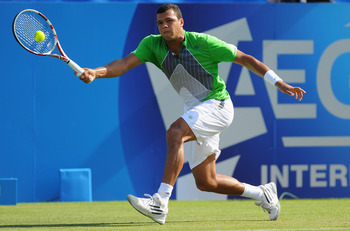 EASTBOURNE, ENGLAND - JUNE 14:  Jo-Wilfred Tsonga of France in action against Denis Istomin of Uzbekistan during day four of the AEGON International at Devonshire Park on June 14, 2011 in Eastbourne, England.  (Photo by Mike Hewitt/Getty Images)