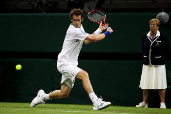 LONDON, ENGLAND - JUNE 20:  Andy Murray of Great Britain hits a backhand during his first round match against Daniel Gimeno-Traver of Spain on Day One of the Wimbledon Lawn Tennis Championships at the All England Lawn Tennis and Croquet Club on June 20, 2