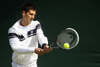 WIMBLEDON, ENGLAND - JUNE 18:  Serbian tennis player Novak Djokovic trains on court 6 at the All England Lawn Tennis and Croquet Club ahead of the Wimbledon Lawn Tennis Championships on June 18, 2011 in London, England. The Championships which are celebra
