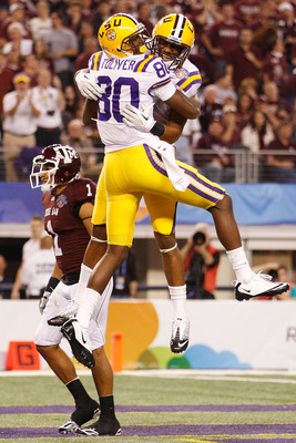 ARLINGTON, TX - JANUARY 07:  Terrence Toliver #80 and Rueben Randle #2 of the Louisiana State University Tigers celebrate after Toliver scored a touchdown against the Texas A&M Aggies during the AT&T Cotton Bowl at Cowboys Stadium on January 7, 2011 in Ar