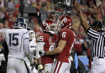 GLENDALE, AZ - JANUARY 01:  Ryan Broyles #85 of the Oklahoma Sooners celebreates with teammate Cameron Kenney #6 after Broyles scores a five-yard touchdown catch in the fourth quarter against Connecticut Huskies during the Tostitos Fiesta Bowl at the Univ