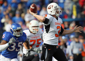 LAWRENCE, KS - NOVEMBER 20:  Quarterback Brandon Weeden #3 of the Oklahoma State Cowboys passes during the game against  the Kansas Jayhawks on November 20, 2010 at Memorial Stadium in Lawrence, Kansas.  (Photo by Jamie Squire/Getty Images)