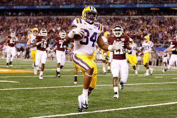ARLINGTON, TX - JANUARY 07:  Stevan Ridley #34 of the Louisiana State University Tigers runs in for a touchdown during the game against the Texas A&M Aggies during the AT&T Cotton Bowl at Cowboys Stadium on January 7, 2011 in Arlington, Texas.  (Photo by