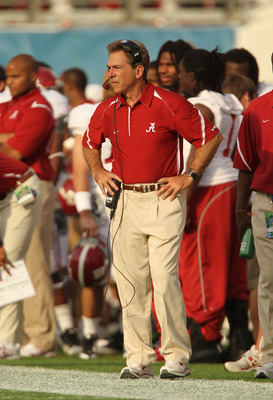 ORLANDO, FL - JANUARY 01:  Alabama Crimson Tide Head Coach Nick Saban stands on the sideline during the Capitol One Bowl against the Michigan State Spartans at the Florida Citrus Bowl on January 1, 2011 in Orlando, Florida.  (Photo by Mike Ehrmann/Getty I