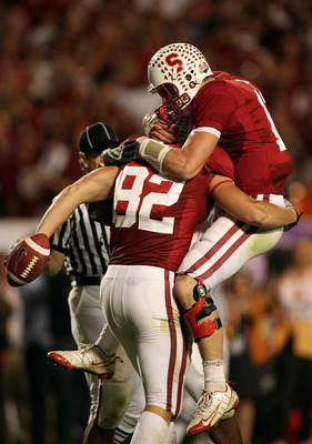 MIAMI, FL - JANUARY 03: Quarterback Andrew Luck #12 and Coby Fleener #82 of the Stanford Cardinal celebrate after Luck threw Fleener a 41-yard touchdown pass in the third quarterback against the Virginia Tech Hokies during the 2011 Discover Orange Bowl at