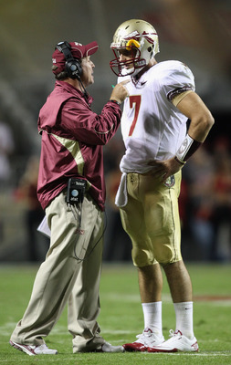 RALEIGH, NC - OCTOBER 28:  Head coach Jimbo Fisher and quarterback Christian Ponder #7 of the Florida State Seminoles prepare for a play against the North Carolina State Wolfpack at Carter-Finley Stadium on October 28, 2010 in Raleigh, North Carolina.  (P