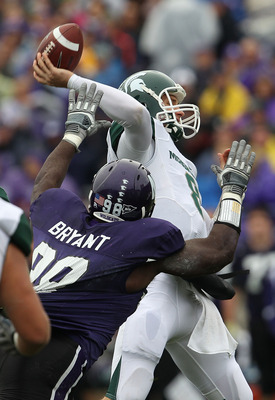 EVANSTON, IL - OCTOBER 23: Kirk Cousins #8 of the Michigan State Spartans throws a pass under pressure from Corbin Bryant #98 of the Northwestern Wildcats at Ryan Field on October 23, 2010 in Evanston, Illinois. (Photo by Jonathan Daniel/Getty Images)