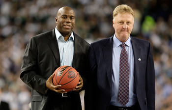 DETROIT - APRIL 06:  Larry Bird (R) and Earvin 'Magic' Johnson walk on the court to be honored for the 30th anniversary of their match up in 1979 NCAA Championship Game between Indiana State and Michigan State prior to the Michigan State Spartans playing