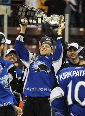 MISSISSAUGA, CANADA - MAY 29:  Nathan Beaulieu #28 of the Saint John Sea Dogs celebrates with the Memorial Cup after the win against the Mississauga St. Michael's Majors in the 2011 CHL Mastercard Memorial Cup final on May 29, 2011 at the Hershey Centre i