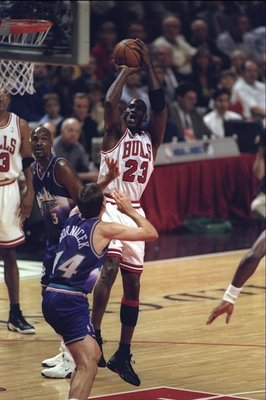 10 Jun 1998:  Michael Jordan #23 of the Chicago Bulls in action against Jeff Hornasek of the Utah Jazz during the NBA Finals Game 4 at the United Center in Chicago, Illinois.  The Bulls defeated the Jazz 86-82. Mandatory Credit: Jonathan Daniel  /Allsport