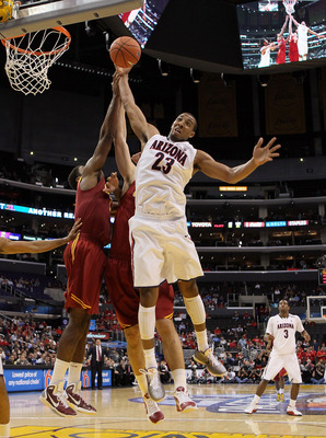 LOS ANGELES, CA - MARCH 11:  Derrick Williams #23 of the Arizona Wildcats goes up for a rebound in front of Alex Stepheson #1 of the USC Trojans in the second half in the semifinals of the 2011 Pacific Life Pac-10 Men's Basketball Tournament at Staples Ce