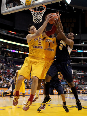 LOS ANGELES, CA - MARCH 10:  Nikola Vucevic #5 and Alex Stepheson #1 of the USC Trojans battle for a rebound with Markhuri Sanders-Frison #10 of the California Golden Bears in the second half in the quarterfinals of the 2011 Pacific Life Pac-10 Men's Bask