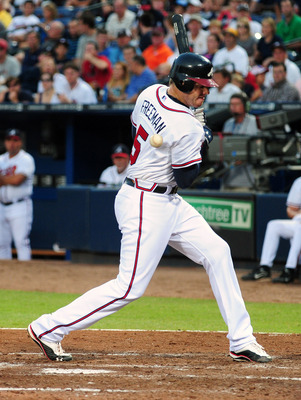 ATLANTA - JUNE 20: Freddie Freeman #5 of the Atlanta Braves is hit by a pitch by Ricky Romero #24 of the Toronto Blue Jays at Turner Field on June 20, 2011 in Atlanta, Georgia. (Photo by Scott Cunningham/Getty Images)