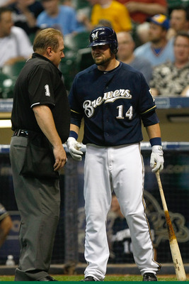 MILWAUKEE, WI - JUNE 8: Casey McGehee #14 of the Milwaukee Brewers argues a call with umpire Bruce Dreckman #1 during the game against the New York Mets at Miller Park on June 8, 2011 in Milwaukee, Wisconsin. The Brewers defeated the Mets 7-6. (Photo by S